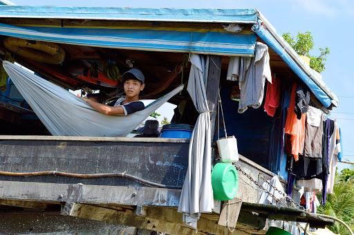 vietnam-boy-hammock.jpg - A boy in a hammock is part of life in a floating village on the Mekong River in Vietnam.