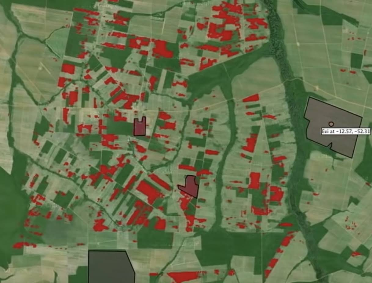Overhead view of farmland with some plots marked in red