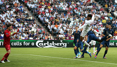 Photo: DONETSK, UKRAINE - JUNE 11:  Joleon Lescott of England scores the first goal past Hugo Lloris of France during the UEFA EURO 2012 group D match between France and England at Donbass Arena on June 11, 2012 in Donetsk, Ukraine.  (Photo by Ian Walton/Getty Images)
