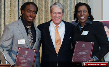Photo: Turner accompanied Quinton Carter (left) when he was awarded the Wooden Cup in 2011 for outstanding community service..