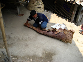 Photo: A local roofer making a ridgecap (12 baht/lineal foot)