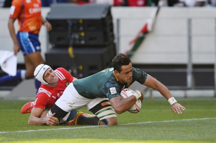 Chris Dry of South Africa scores a try during day 1 of the 2017 HSBC Cape Town Sevens match between South Africa and France at Cape Town Stadium on December 09, 2017 in Cape Town.