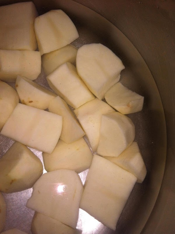 (Optional -Cook bacon. crumble and set aside.)  Peel potatoes and chop in to quarters...