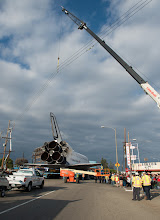 Photo: Power lines are hoisted upwards by a crane in order to allow the space shuttle Endeavour to traverse on its path to its new home at the California Science Center, Friday, Oct. 12, 2012 in Inglewood. Endeavour, built as a replacement for space shuttle Challenger, completed 25 missions, spent 299 days in orbit, and orbited Earth 4,671 times while traveling 122,883,151 miles. Beginning Oct. 30, the shuttle will be on display in the CSC's Samuel Oschin Space Shuttle Endeavour Display Pavilion, embarking on its new mission to commemorate past achievements in space and educate and inspire future generations of explorers. Photo Credit: (NASA/Carla Cioffi)