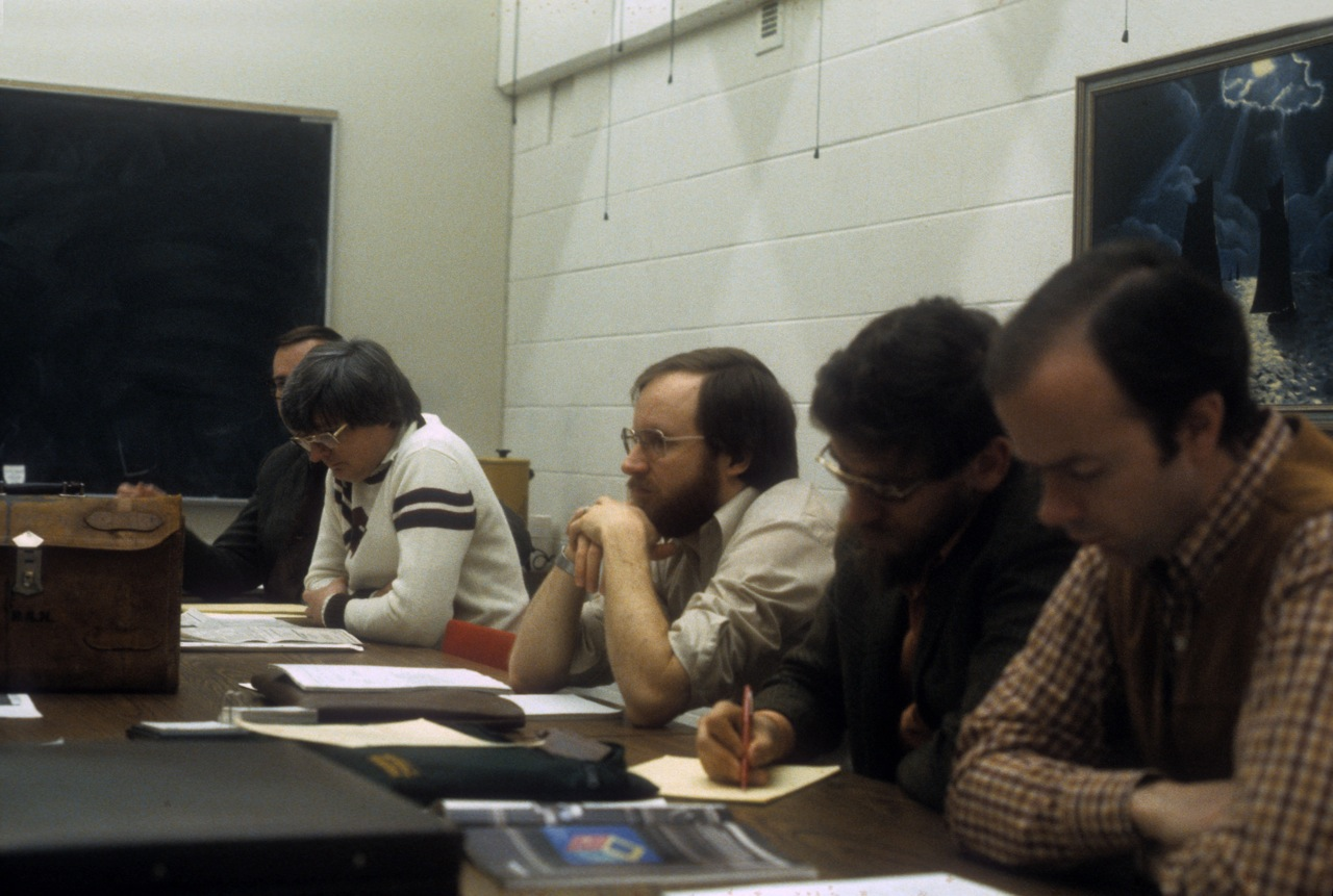 Photo: l to r: ?, Clark Lubbers (UM), Bruce Cowan (SFU), Wilson Dillaway (RPI), Herb Lee (RPI), 3rd floor conference room, Computing Center, University of Michigan, Ann Arbor, Michigan, USA, c. 1982