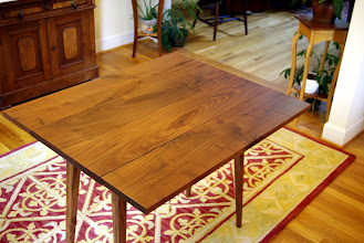 """Photo: The same table with the leaves raised.  Notice the beautifully knotted black walnut.  I was able to """"butterfly"""" the two top boards and the two leaves; They came from two sequentially sawn planks of the same tree."""