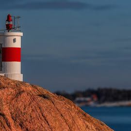 Femöre Lighthouse by Micke Holmberg - Landscapes Waterscapes ( lighthouse, seaside, sweden, cliff, winter, water, sea, canon )