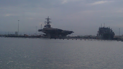 Photo: A carrier. There were sour submarines at dock also.