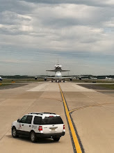 Photo: Flanked by commercial planes, Discovery stands out! by Malia Rulon