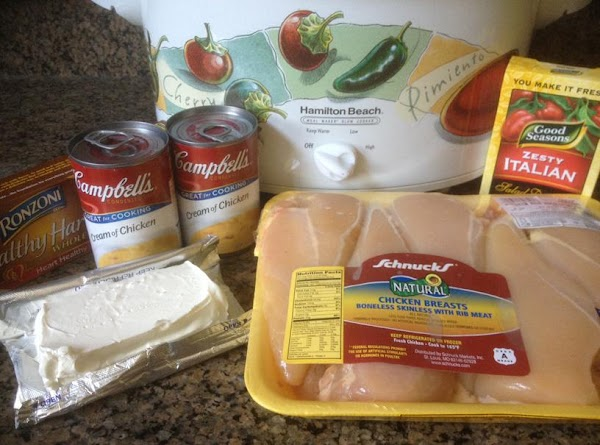Add all the ingredients except the pasta into the crockpot.  Cook on low...
