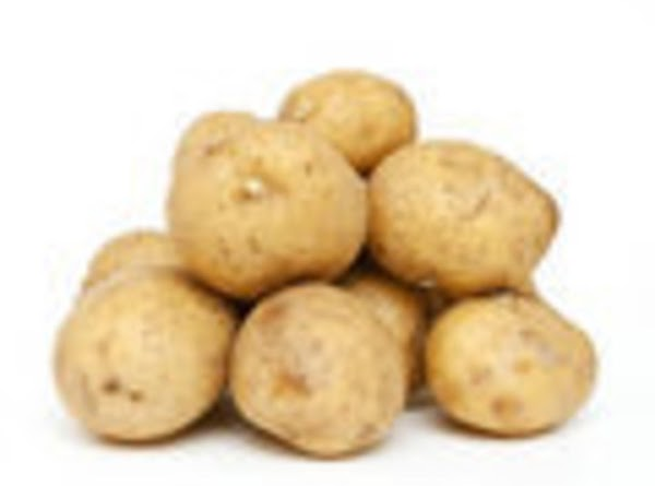 Peel all of the potatoes, cook until done, but not mushy. You want them...