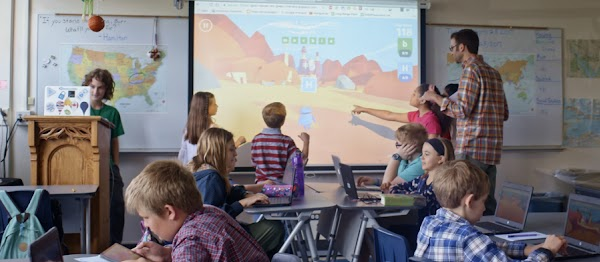 Students engage with a video screen in a connected classroom
