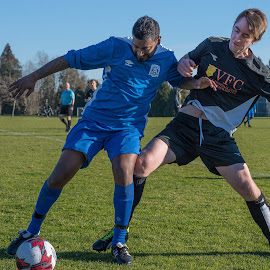 Blocked From Reaching The Ball by Garry Dosa - Sports & Fitness Soccer/Association football ( ball, soccer, sports, outdoors, teams, rugby, action, competitive, males, people, movement, sport )