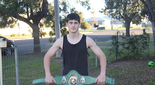 Jackson Walsh with the National Novice Title belt which he won on Saturday night in the National Novice Boxing Titles in Woy Woy, after winning both of his fights at the event.