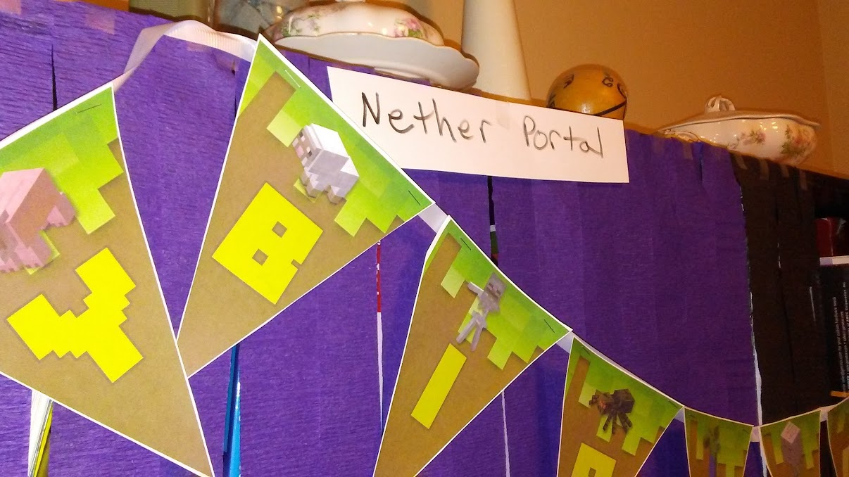 A Minecrafty Birthday banner, and the sign clarifying that the purple and black are a Nether Portal, just in case I didn't get it.