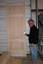 Photo: February 2006 - Month 30: Raymond checking out the new hardware. This panel is not actually a door. It it one of the two 10' tall side panels for the vestibule.