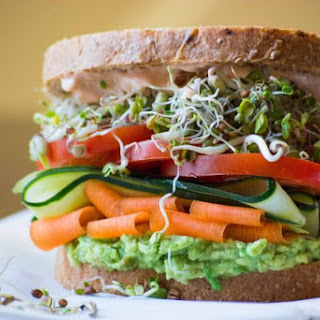 Stacked Vegetable & Sprouts Sandwich.