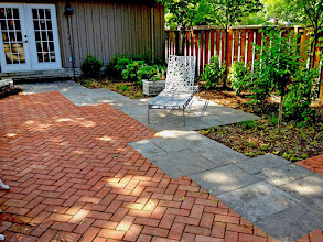 Photo: Double-fired clay brick and square-cut limestone flag make this yard elegant and useful. See the gaps? It's designed to be permeable. Designed by Carson Arthur and installed by Fern Ridge.
