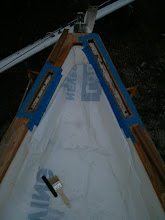 Photo: Bow masked off in preparation for setting large splines at bow in place with thickened epoxy.