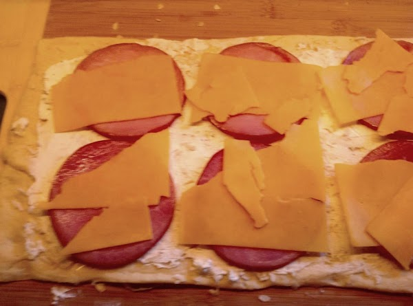 layer the canadian bacon and cheddar over top