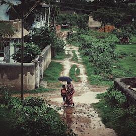 The rains by D K - City,  Street & Park  Street Scenes ( child, school, street, india, rain )