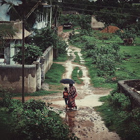 The rains by D K - City,  Street & Park  Street Scenes ( child, school, street, india, rain )