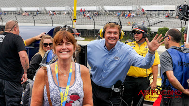 Photo: She chased Fox broadcaster and Long Island native Bob Dillner up and down pit road, hoping to get a photo with him. When she least expects it - PHOTO BOMB!
