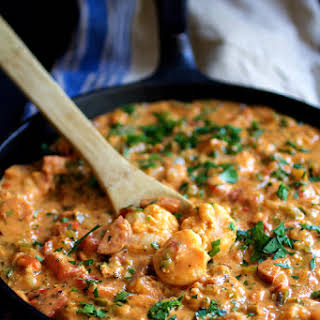 Smothered Shrimp with Andouille Sausage and Creamy Parmesan Peppercorn Grits.