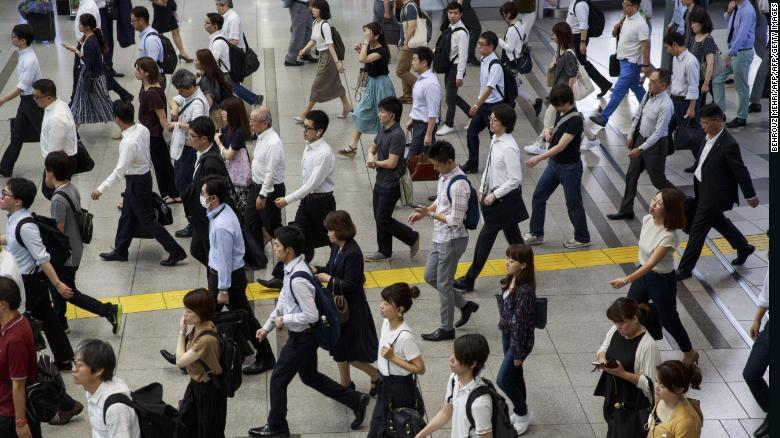 People commute during a morning rush hour at Shinagawa station in Tokyo, July 18, 2019.