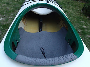Photo: Cockpit area. White foam protects legs from bilge pump when entering and exiting. Grey foam is new seat. No backband, but one can be installed easily using the lines on the seat hanger and the clip in and bungee shown in foreground.