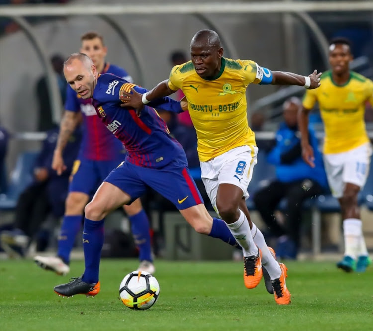 Hlompho Kekana (c) of Mamelodi Sundowns shields the ball from A. Iniesta (c) of Barcelona during the International Club Friendly match between Mamelodi Sundowns and Barcelona FC at FNB Stadium on May 16, 2018 in Johannesburg, South Africa.