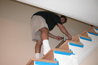 Photo: August 2006 - Month 36: Andrew finishing the 3rd floor stairs