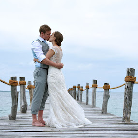 On the boardwalk by Andrew Morgan - Wedding Bride & Groom ( love, kiss, blue, wedding, sea, pier, beauty, bridge )