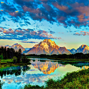 Oxbow Bend at sunrise by John Broughton - Landscapes Mountains & Hills ( firery clouds, mountains, relections, still waters, sunrise )