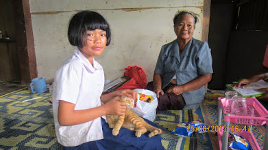 Photo: Wiang Haeng: Alinya and grandmother and cat.