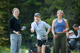 Photo: young women playing bocce ball while camping on Jackson Lake. Grand Teton NP, WY