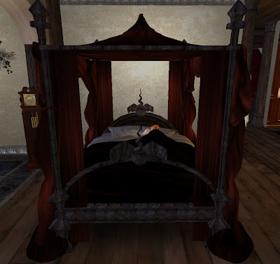 New at Rustica, the Shades of Black Gothic Canopy Bed is an elaborately  sculpted beauty that would be an asset to any home or castle.
