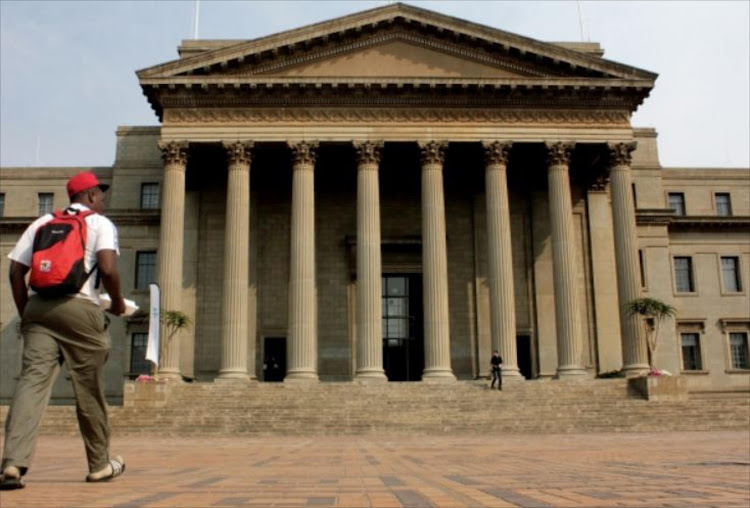 A student heads to the Great Hall at Wits University, Johannesburg. Picture: SIHLE MAKU/THE TIMES