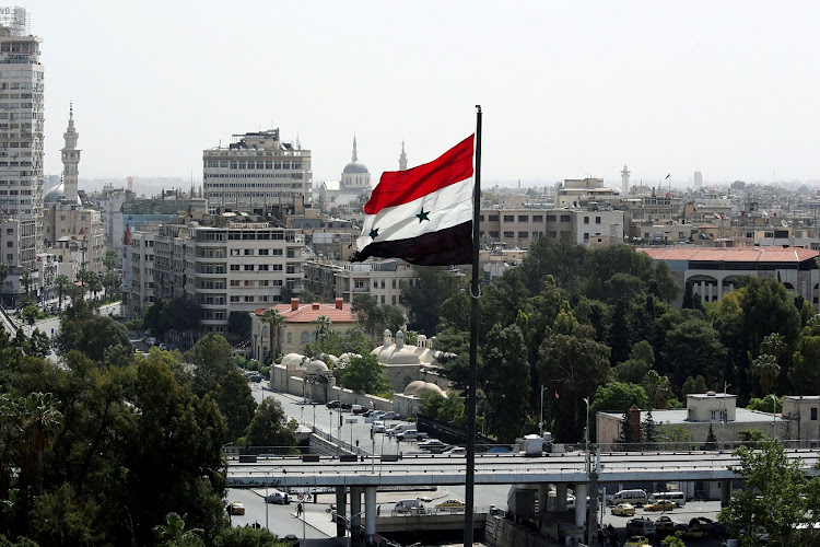 A Syrian flag flutters in Damascus, Syria. File photo: REUTERS/AlLI HASHISHO