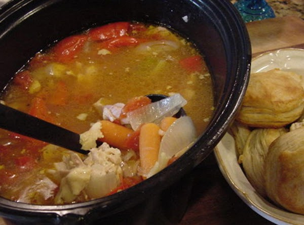 Wash chicken thighs, add to slow cooker. Prepare the vegetables and cut them into...