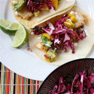 "Fish Tacos with Mango-Acovado relish, Red Cabbage Slaw, and Chipotle Lime ""Crema""."