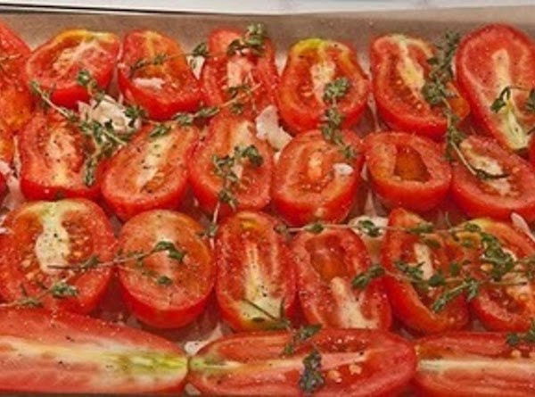 Toss the halved tomatoes with the chopped onions,  2 Tablespoons of the olive...