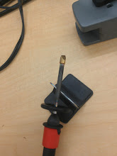 Photo: Misusing a soldering iron as a heat-sealing device.