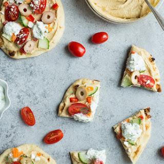 Veggie-Loaded Flatbread Pizza with Hummus and Tzatziki