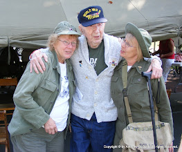 Photo: Man and singers, from left; Jeanne Keith, Pen Brook, N.H.; Arthur 'Pat' Engeberg, Louisville, Ohio (98 years old) served in 100th Inf. Div. 399th Reg. ; Diane Kuebler, Newton, Mass.