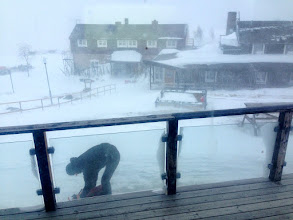 Photo: Lukáš burying our deep-frozen food reserves in the snow next to the hut.