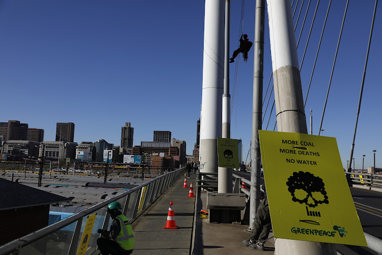 A group of Greenpeace Africa activists attempted to scale the iconic Nelson Mandela Bridge in Braamfontein' Johannesburg' to hoist a 'coal kills' banner. Greenpeace were protesting the inclusion of coal-fired energy in government's latest draft Integrated Resource Plan (IRP) ' released on Monday. Melita Steele' senior climate and energy campaign manager' said' 'The banner we are trying to drop states 'more coal' more death' no water.''