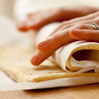 Cardamom, pistachio and coffee Swiss roll.