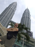 Dean in front of the Patronas Towers in Kuala Lumpur, Malaysia