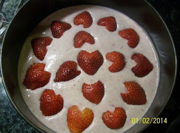 Pour your strawberry cheese cake mixture ,over your prepare base , cut your fresh...